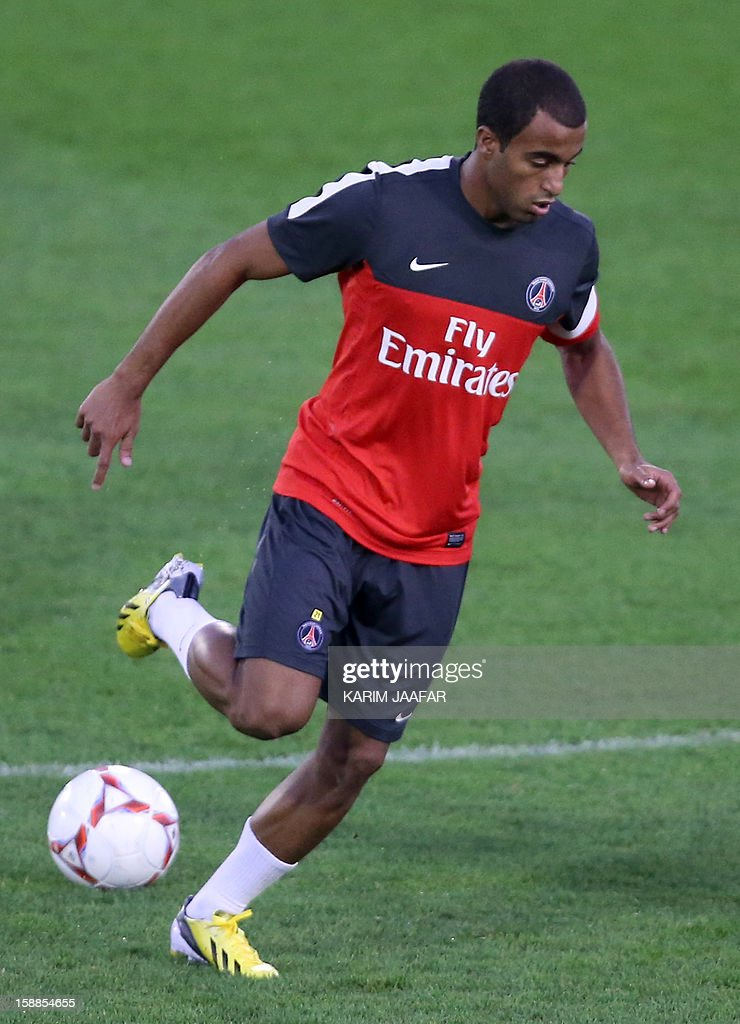 Paris Saint-Germain (PSG)'s Brazilian midfielder Lucas Moura controls the ball during his first training session with his new teammates at the Aspire Academy of Sports Excellence in the Qatari capital Doha on January 1, 2013. Moura said he is ready to embrace the 'challenge' at an evolving Paris Saint-Germain.