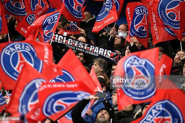 Paris SaintGermain supporters cheer for their team during the Champions League round of 16 first leg football match between Paris SaintGermain and...