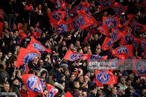 Paris SaintGermain supporters cheer for their team during the Champions League round of 16 first leg football match between Paris SaintGermain and...
