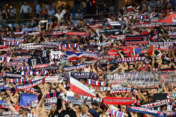 Paris SaintGermain supporters hold scarves during the French Cup final football match between Paris SaintGermain and Angers on May 27 at the Stade de...