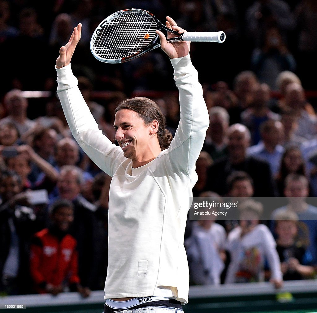 Paris Saint-Germain' Swedish Zlatan Ibrahimovic (in the photo) plays a show game with Serbian Novak Djokovic after Djokovic's semi final victory against Roger Federer at the BNP Paris Masters tennis tournament at Bercy Arena on November 2, 2013 in Paris, France.