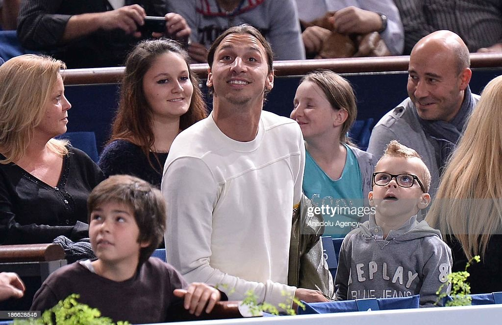 Paris Saint-Germain' Swedish Zlatan Ibrahimovic (front row M) watches the men's single semi final match btw Swiss Roger Federer and Serbian Novak Djokovic at the BNP Paris Masters tennis tournament at Bercy Arena on November 2, 2013 in Paris, France.