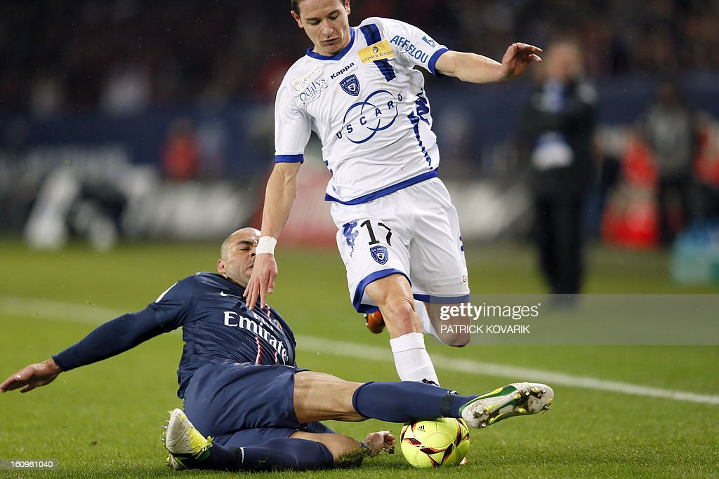 Paris Saint-Germain's Alex (L) vies with Bastia's Florian Thaivin during the French L1 football match Paris Saint-Germain (PSG) vs Bastia, on February 8, 2013 at the Parc des Princes stadium in Paris.