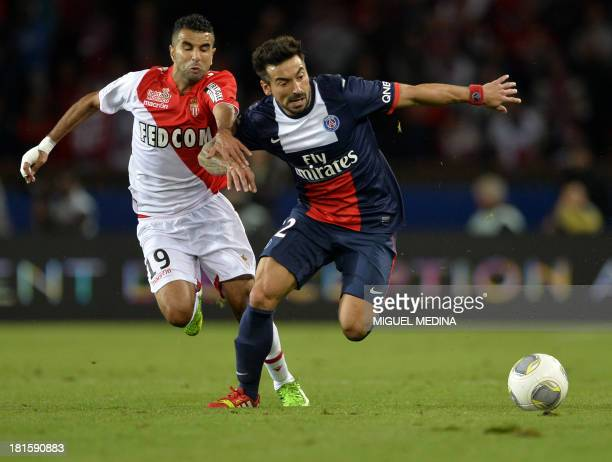 Paris SaintGermain's Argentine forward Ezequiel Lavezzi challenges Monaco's Moroccan midfielder Mounir Obbadi during the French L1 football match...