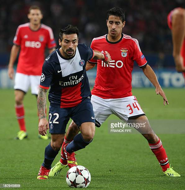 Paris SaintGermain's Argentine forward Ezequiel Lavezzi holds off Benfica's defender Andre Almeida during a Group C Champions League football match...