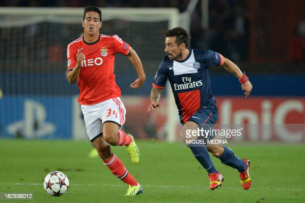 Paris SaintGermain's Argentine forward Ezequiel Lavezzi runs past Benfica's defender Andre Almeida during a Group C Champions League football match...