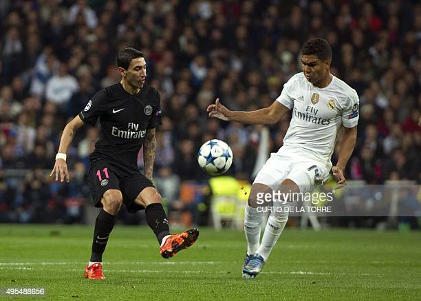 Paris SaintGermain`s Argentinean midfielder Angel Di Maria vies with 4 Real Madrid's Brazilian midfielder Casemiro during the UEFA Champions League...