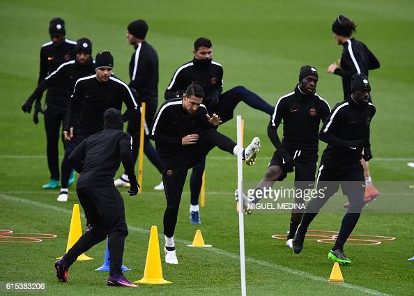 Paris SaintGermain's argentinian forward Angel Di Maria and teammates stretch during a training session at the Ooredoo PSG training center on October...