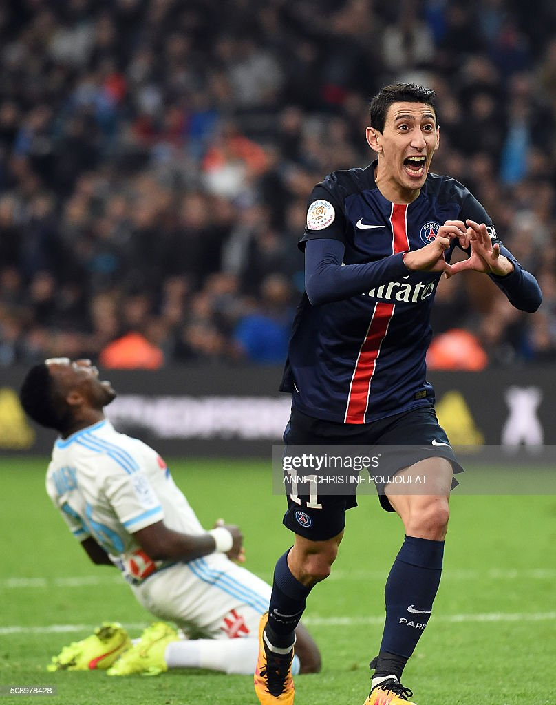 Paris Saint-Germain's Argentinian forward Angel Di Maria celebrates after scoring a goal during the French L1 football match between Marseille and Paris-Saint-Germain on February 7, 2015 at the Velodrome stadium in Marseille, southern France. AFP PHOTO / ANNE-CHRISTINE POUJOULAT / AFP / ANNE-CHRISTINE POUJOULAT