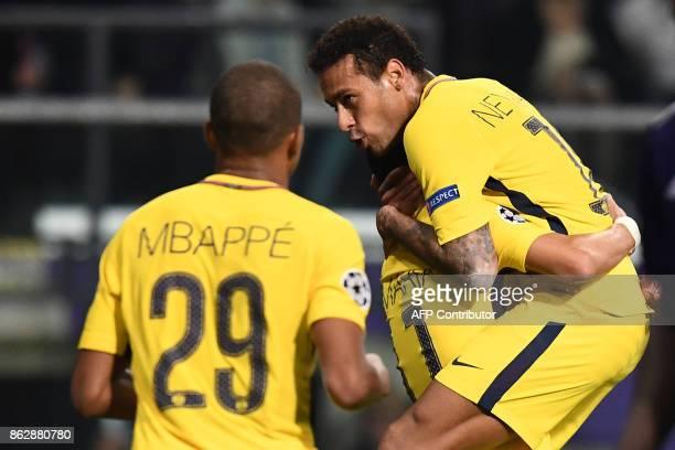 Paris SaintGermain's Argentinian forward Angel Di Maria celebrates after scoring a goal with Paris SaintGermain's Brazilian forward Neymar and Paris...