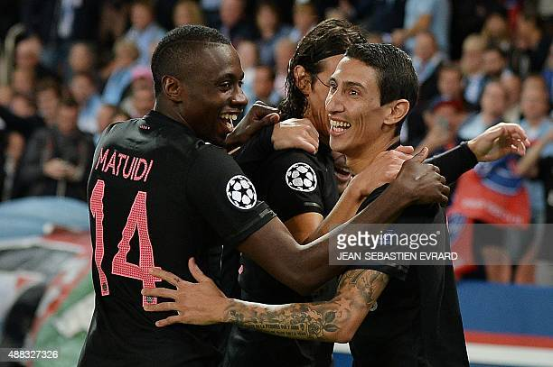 Paris SaintGermain's Argentinian forward Angel Di Maria celebrates with teammates after scoring a goal during the UEFA Champions League group A...