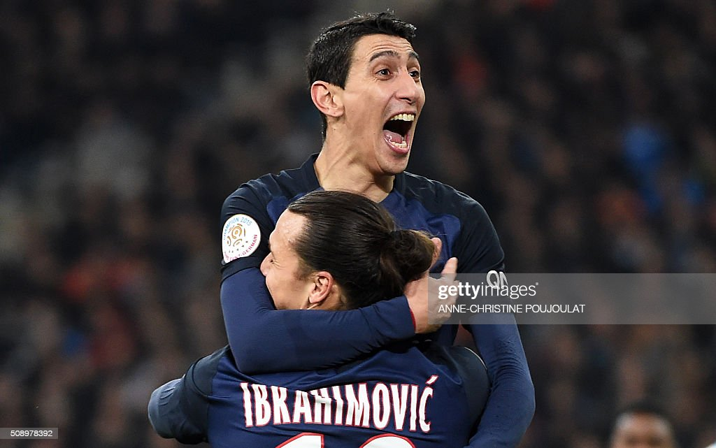 Paris Saint-Germain's Argentinian forward Angel Di Maria (TOP) celebrates with Paris Saint-Germain's Swedish forward Zlatan Ibrahimovic after scoring a goal during the French L1 football match between Marseille and Paris-Saint-Germain on February 7, 2015 at the Velodrome stadium in Marseille, southern France. AFP PHOTO / ANNE-CHRISTINE POUJOULAT / AFP / ANNE-CHRISTINE POUJOULAT