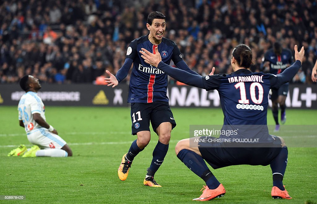 Paris Saint-Germain's Argentinian forward Angel Di Maria (C) celebrates with Paris Saint-Germain's Swedish forward Zlatan Ibrahimovic (R) after scoring a goal during the French L1 football match between Marseille and Paris-Saint-Germain on February 7, 2015 at the Velodrome stadium in Marseille, southern France. AFP PHOTO / ANNE-CHRISTINE POUJOULAT / AFP / ANNE-CHRISTINE POUJOULAT