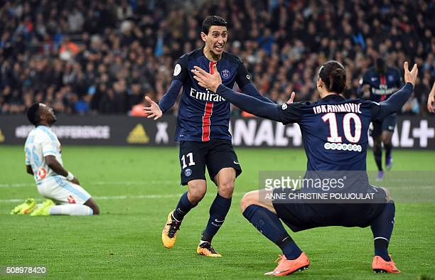 TOPSHOT Paris SaintGermain's Argentinian forward Angel Di Maria celebrates with Paris SaintGermain's Swedish forward Zlatan Ibrahimovic after scoring...
