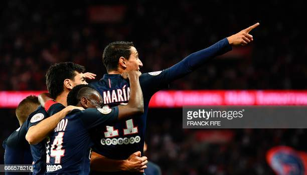 Paris SaintGermain's Argentinian forward Angel Di Maria celebrates with his teammates after scoring a goal during the French L1 football match...
