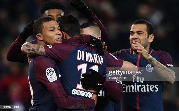 Paris SaintGermain's Argentinian forward Angel Di Maria celebrates with Paris SaintGermain's French forward Kylian Mbappe after scoring the opening...