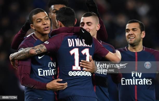 Paris SaintGermain's Argentinian forward Angel Di Maria celebrates with Paris SaintGermain's French forward Kylian Mbappe Paris SaintGermain's...