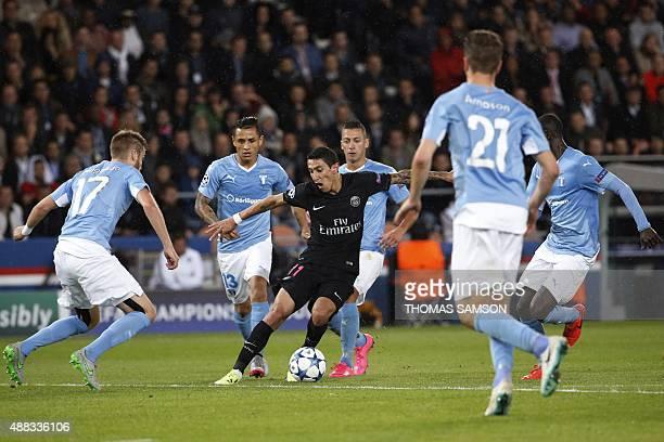 Paris SaintGermain's Argentinian forward Angel Di Maria controls the ball despite of Malmo's players during the UEFA Champions League group A...