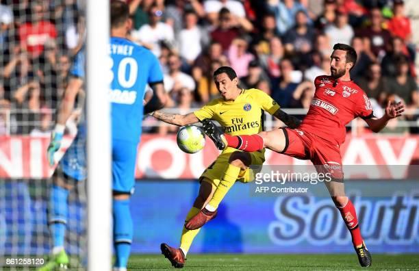TOPSHOT Paris SaintGermain's Argentinian forward Angel Di Maria controls the ball next to Dijon's Tunisian defender Oussama Haddadi during the French...