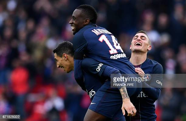 Paris SaintGermain's Argentinian forward Angel Di Maria is congratulated by teammates after scoring a goal during the French L1 football match...