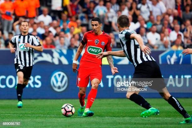 Paris SaintGermain's Argentinian forward Angel Di Maria passes the ball during the French Cup final football match between Paris SaintGermain and...