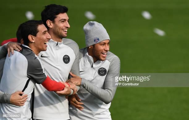 Paris SaintGermain's Argentinian forward Angel Di Maria PSG's Argentinian forward Javier Pastore and PSG's Brazilian forward Neymar attend a training...