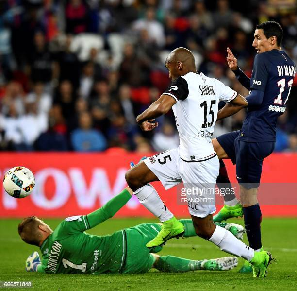 Paris SaintGermain's Argentinian forward Angel Di Maria scores a goal in front of Guingamp's Danish goalkeeper KarlJohan Johnsson and Guingamp's...