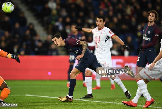 Paris SaintGermain's Argentinian forward Angel Di Maria scores the opening goal with a header during the French L1 football match between Paris...