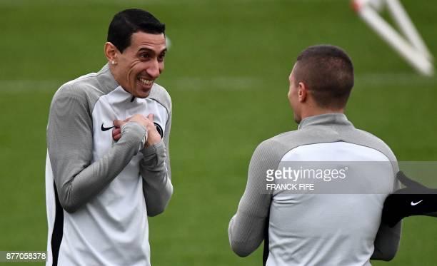 Paris SaintGermain's Argentinian forward Angel Di Maria speaks with Paris SaintGermain's Italian midfielder Marco Verratti during a training session...