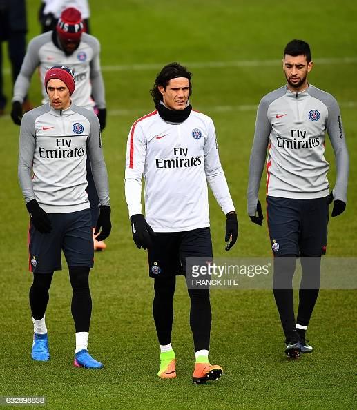 Paris SaintGermain's Argentinian forward Angel Di Maria Uruguayan forward Edinson Cavani and Argentinian forward Javier Pastore attend a training...