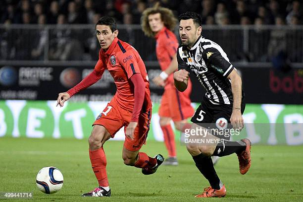 Paris SaintGermain's Argentinian forward Angel Di Maria vies for the ball with Angers' French midfielder Thomas Mangani during the French L1 football...