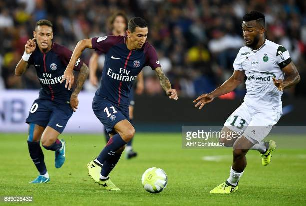 Paris SaintGermain's Argentinian forward Angel Di Maria vies for the ball with SaintEtienne's Ivorian midfielder Habib Maiga during the French L1...