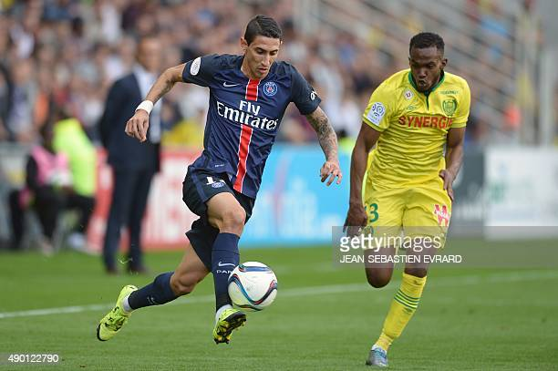 Paris SaintGermain's Argentinian forward Angel Di Maria vies with Nantes' French defender Wilfried Moimbe during the French L1 football match between...