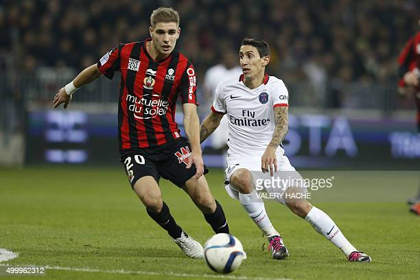 Paris SaintGermain's Argentinian forward Angel Di Maria vies with Nice's French defender Maxime Le Marchand during the French L1 football match Nice...