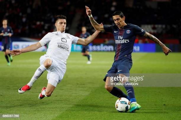 Paris SaintGermain's Argentinian forward Angel Di Maria vies with Caen's Frederic Guilbert during the French L1 football match between Paris...