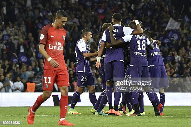 Paris SaintGermain's Argentinian forward Angel Di Maria walks past as Toulouse's players celebrate after defeating Paris SaintGermain's in the French...