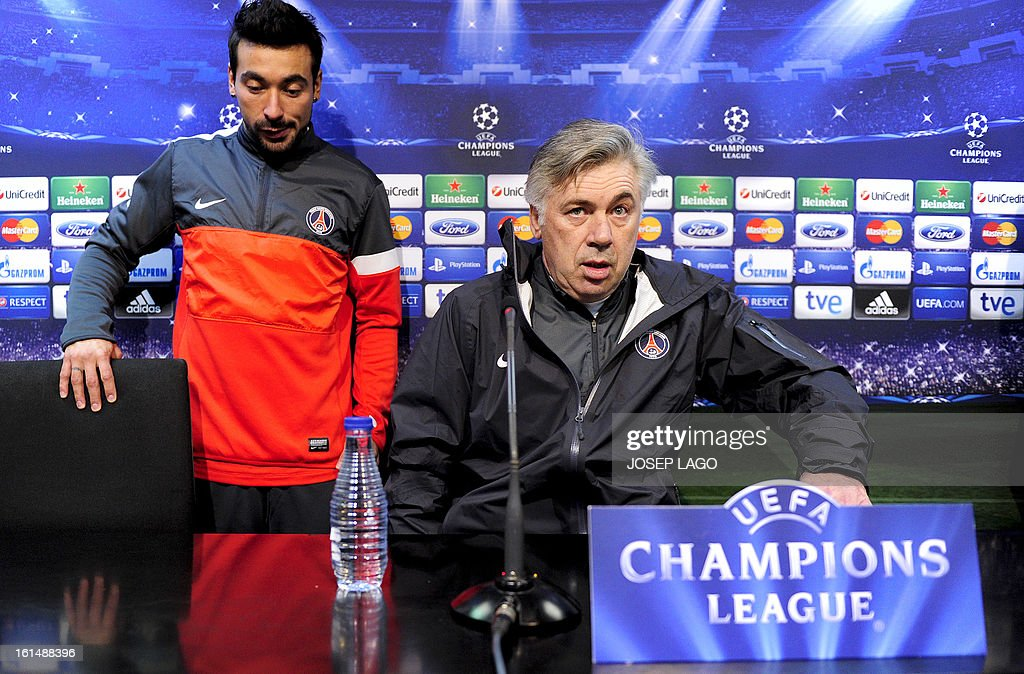 Paris Saint-Germain's Argentinian forward Ezequiel Lavezzi (L) and Paris Saint-Germain's Italian coach Carlo Ancelotti (R) arrive prior to a press conference at Mestalla stadium in Valencia on February 11, 2013 on the eve of their UEFA Champions League football match against Valencia.