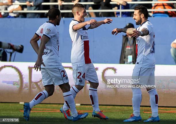 Paris SaintGermain's Argentinian forward Ezequiel Lavezzi is congratulated by his teammates Italian midfielder Marco Verratti and Brazilian...