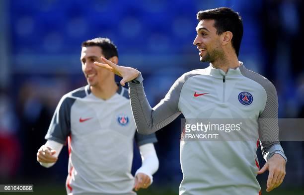 Paris SaintGermain's Argentinian forward Javier Pastore and Paris SaintGermain's Argentinian forward Angel Di Maria react during a training session...