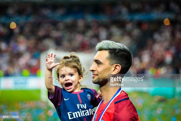 Paris SaintGermain's Argentinian forward Javier Pastore celebrates with a young girl after winning the French Cup final football match between Paris...