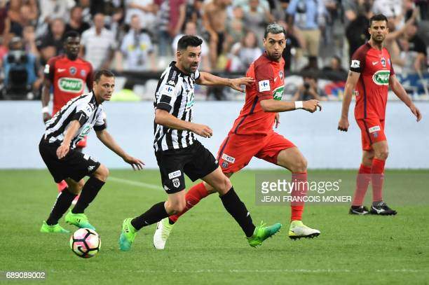 Paris SaintGermain's Argentinian forward Javier Pastore eyes the ball during the French Cup final football match between Paris SaintGermain and...