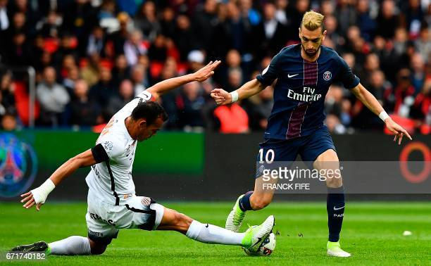 Paris SaintGermain's Argentinian forward Javier Pastore is tackled by Montpellier's Brazilian defender Vitorino Hilton during the French L1 football...