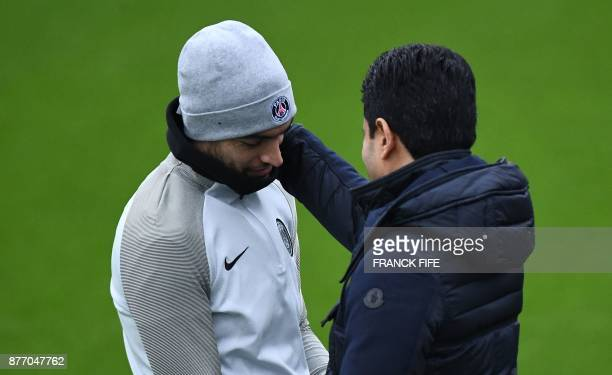 Paris SaintGermain's Argentinian forward Javier Pastore speaks with Paris SaintGermain's Qinari president Nasser AlKhelaifi before a training session...