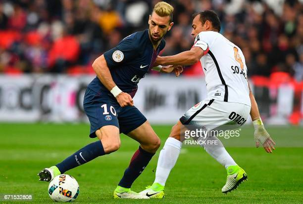 Paris SaintGermain's Argentinian forward Javier Pastore vies with Montpellier's Brazilian defender Vitorino Hilton during the French L1 football...