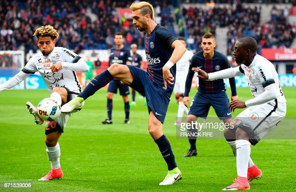 Paris SaintGermain's Argentinian forward Javier Pastore vies with Montpellier's Belgian defender Anthony Vanden Borre during the French L1 football...