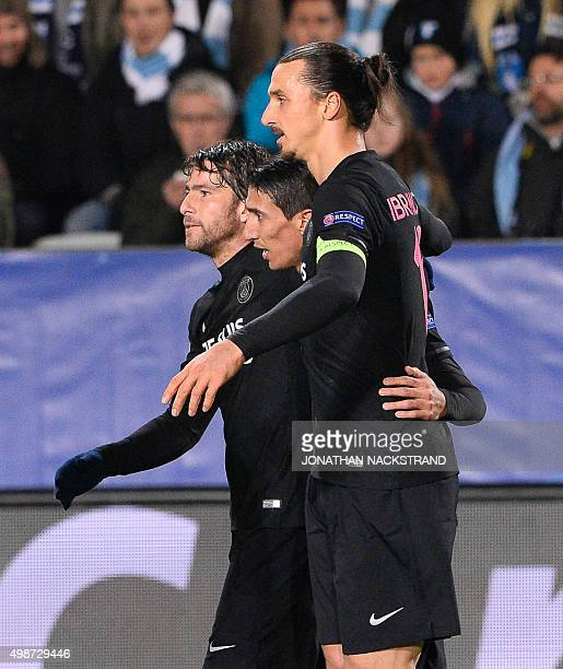 Paris SaintGermain`s Argentinian midfielder Angel Di Maria celebrates with his teammates Swedish forward Zlatan Ibrahimovic and Brazilian defender...