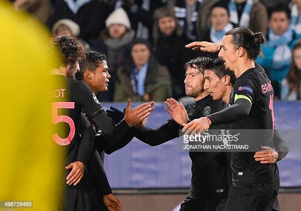 Paris SaintGermain`s Argentinian midfielder Angel Di Maria celebrates with his teammates and Swedish forward Zlatan Ibrahimovic after scoring a goal...