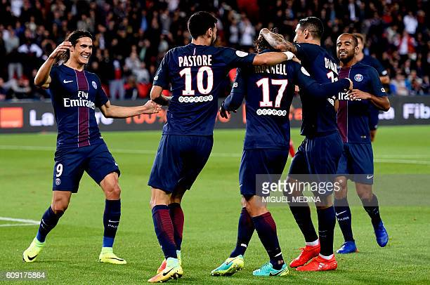 Paris SaintGermain's Argentinian midfielder Javier Pastore and Brazilian defender Maxwell celebrate with teammates after after a play in which Dijon...