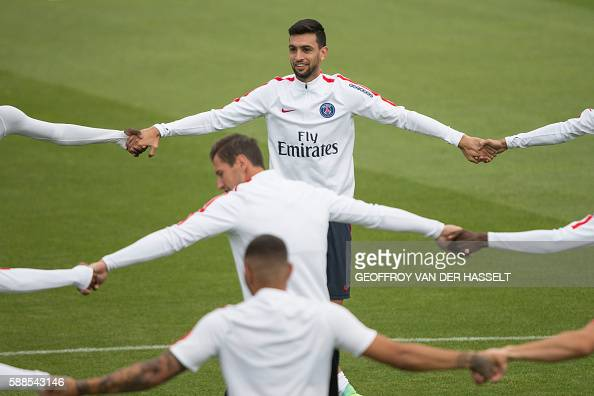 Paris SaintGermain's Argentinian midfielder Javier Pastore and teammates take part in a training session with his team mates at the CampdesLoges in...