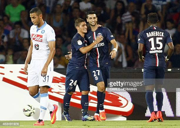 Paris SaintGermain's Argentinian midfielder Javier Pastore celebrates with Italian teammate and midfielder Marco Verratti next to French teammate and...